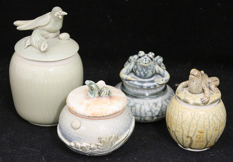 130. Four Ray Neye Art Pottery Covered Vessels | $354