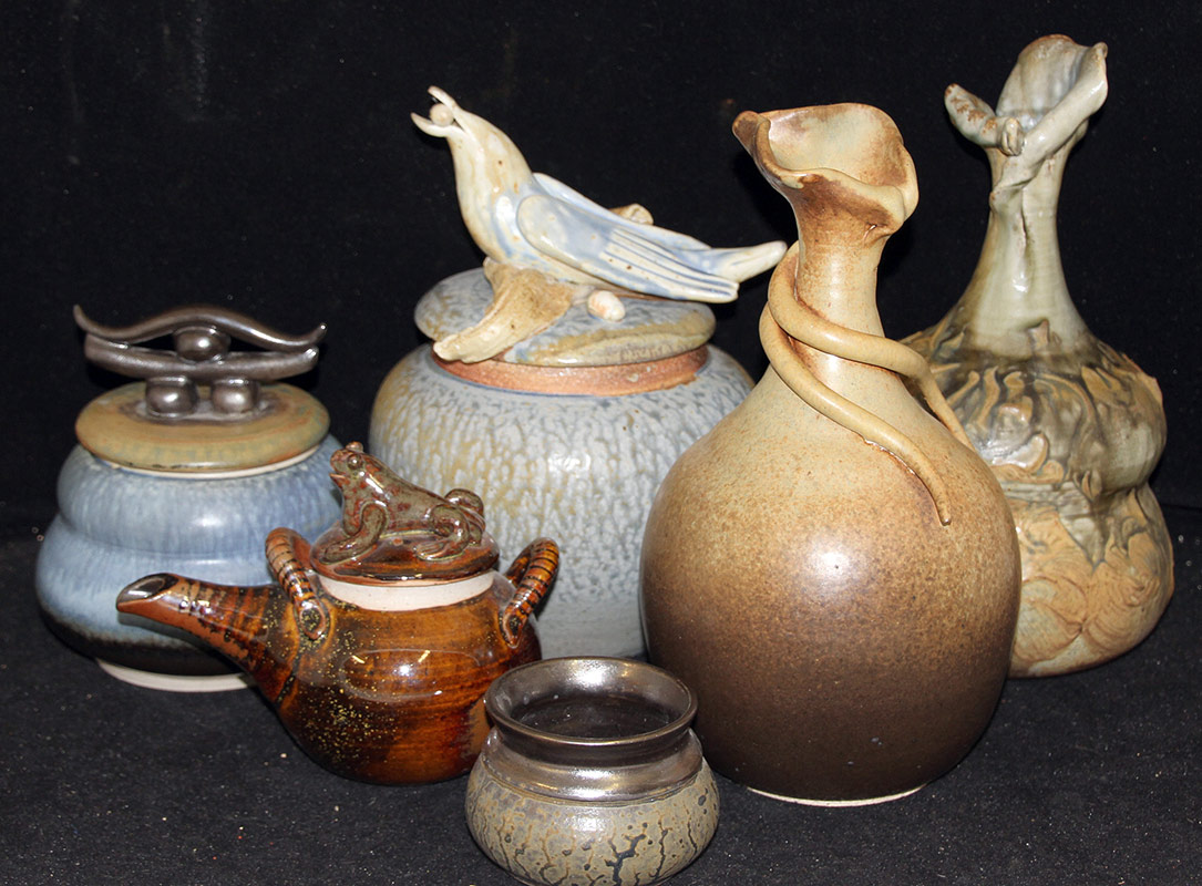 156. Six Ray Neye Art Pottery Vessels | $472