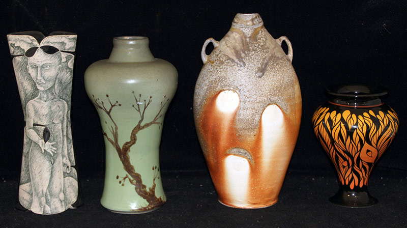 157. Four Studio Pottery Vases | $177