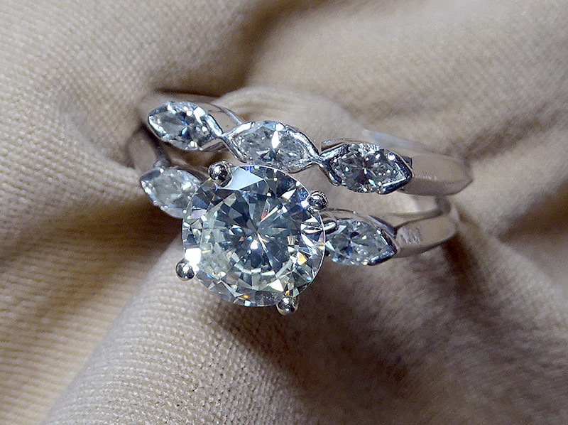 218. Platinum-set Diamond Engagement Ring & Band | $8,850