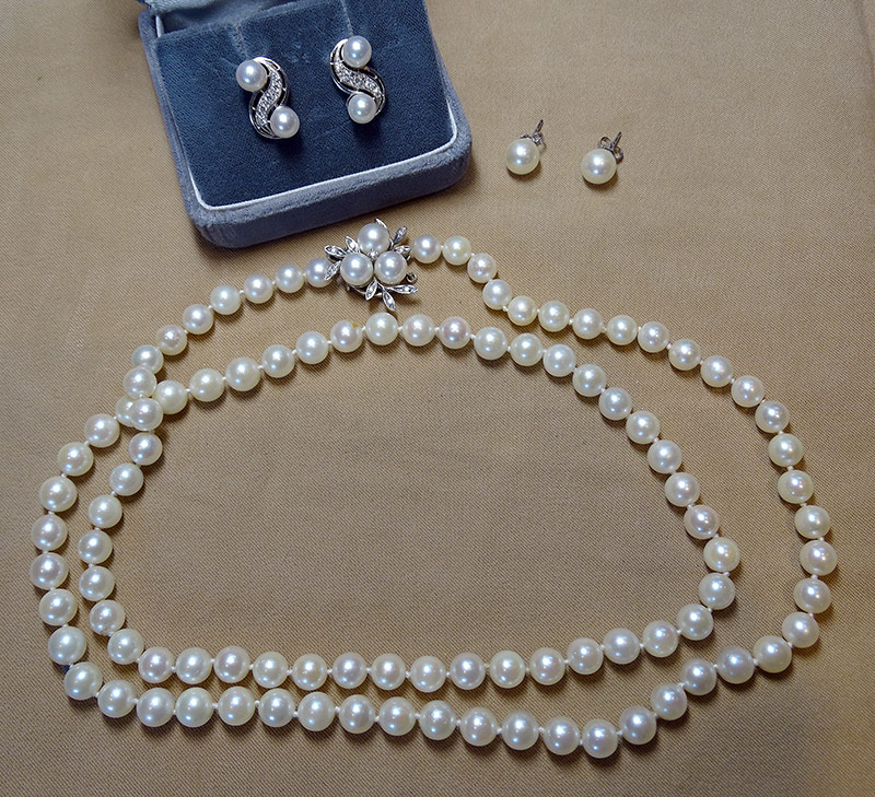 219. Pearl Necklace and Two Pairs of Pearl Earrings | $354