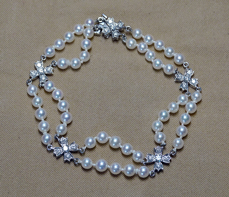 230. Tiffany & Co. Pearl and Diamond Bracelet | $1,476
