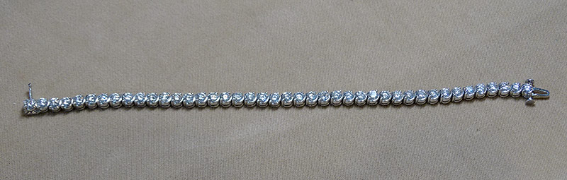 233. Diamond Tennis Bracelet in 14K White Gold | $5,664