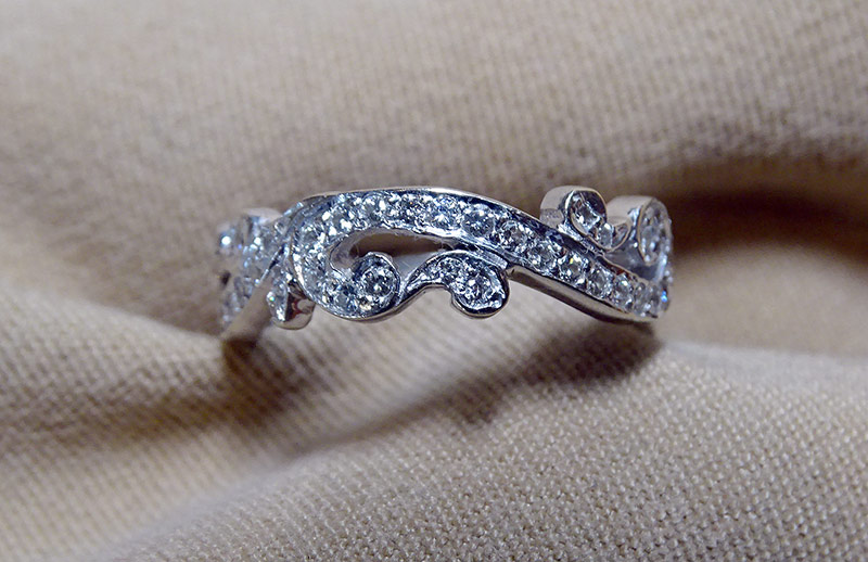 240. Scroll-Design Diamond Band Ring in 18K White Gold | $369