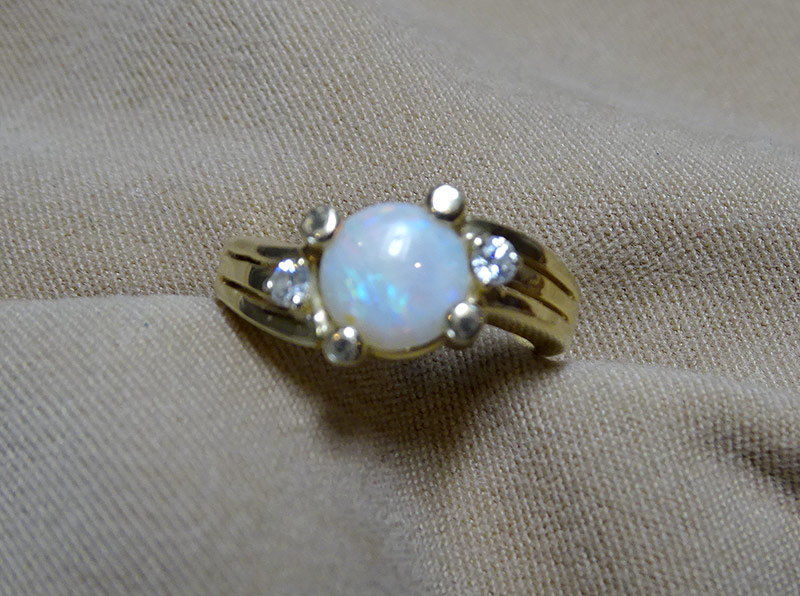 242. Opal Cabochon & Diamond Ring in 14K Yellow Gold | $177