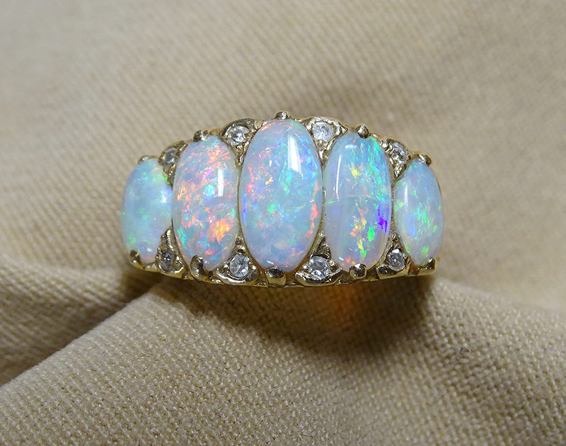 243. Opal and Diamond Ring in 14K Yellow Gold | $413