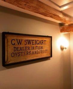 Purchased in our June 2018 Fine Estates Auction, this G.W. Sweigart sign has found a home in a Chester County farmhouse.