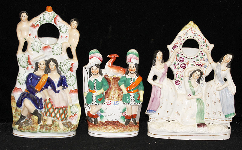 23. Three Staffordshire Figural Watch Holders. $106.20