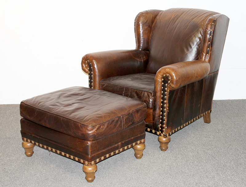 115. Wesley Hall Leather Lounge Chair and Ottoman. $560.50