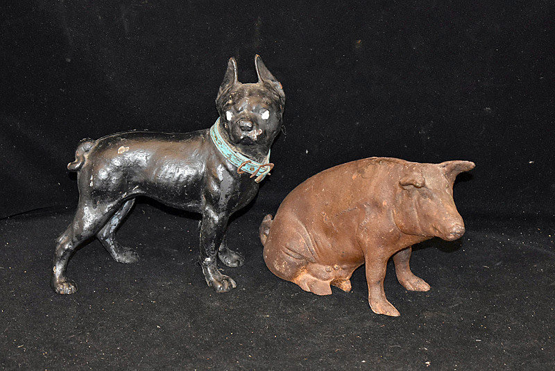 427C. Two Cast Iron Doorstops: Pig Bank, Bulldog. | $106.20