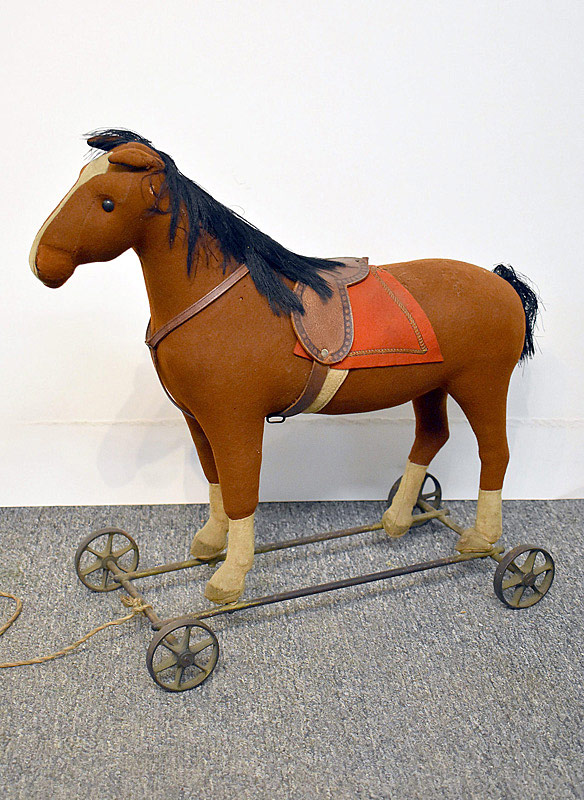 462. Early Steiff Horse on Cast Iron Wheels. | $246