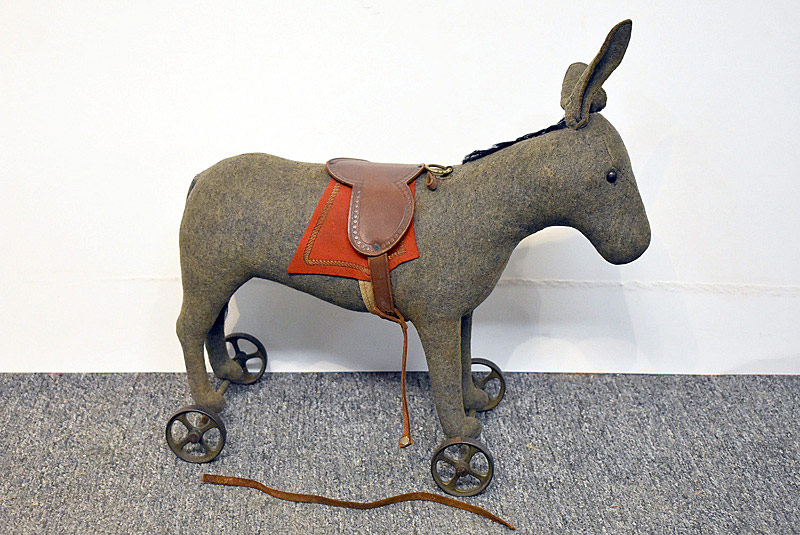 463. Early Steiff Donkey on Cast Iron Wheels. | $584.25