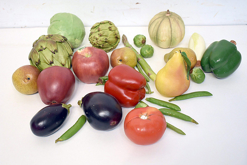 498. Ceramic Fruit and Vegetables, some by Mary Kirk Kelly. | $94.40