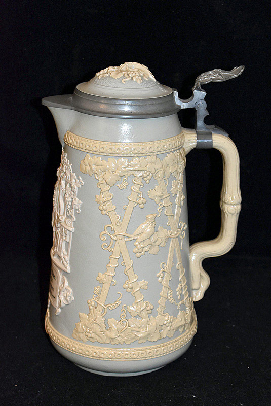 511. 19th C. Mettlach Relief Pitcher, #1821. | $118