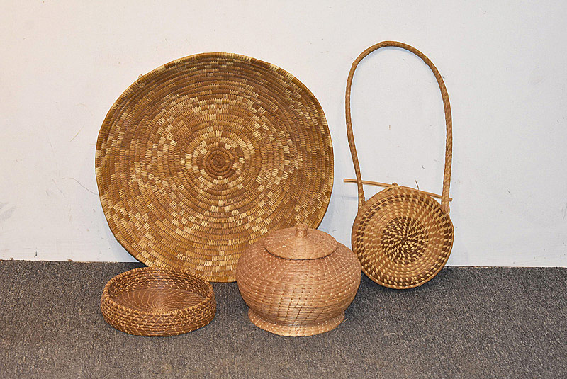559. Four Woven Baskets. | $35.40