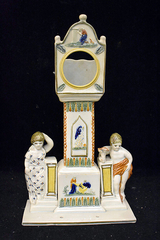 571. Faience Porcelain Figural Watch Holder. | $98.40