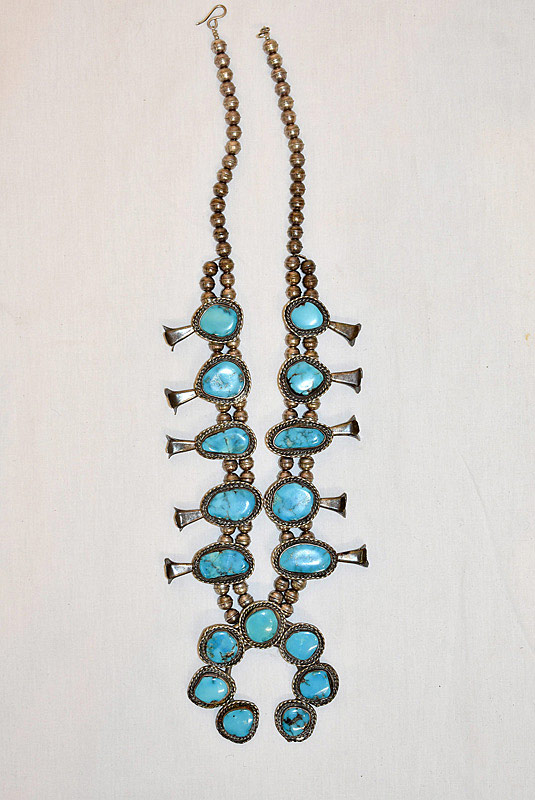 630. Navajo Silver and Turquoise Squash Blossom Necklace. | $442.50