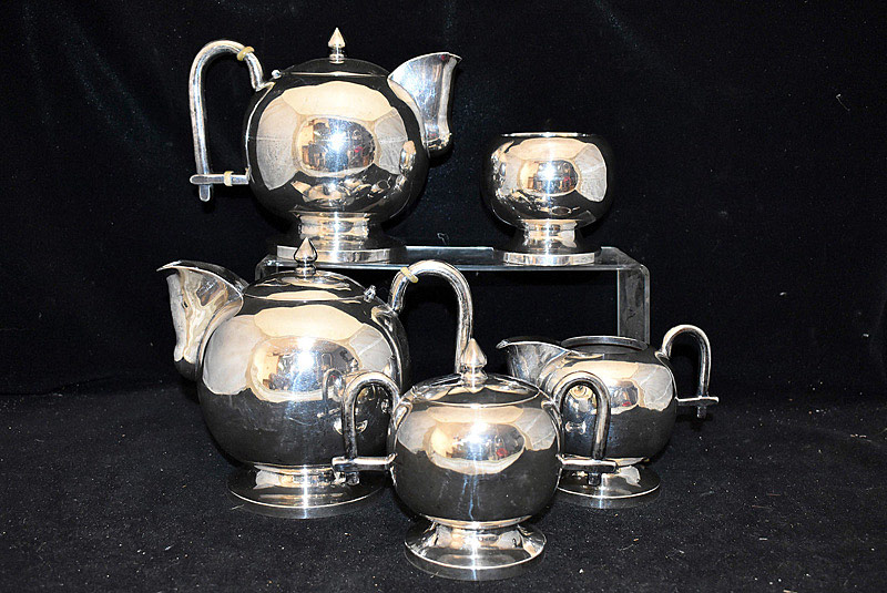 648. Modern Design Five-piece Mexican Sterling Tea Service. | $1,652