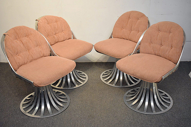 707. Four Woodard Aluminum Swivel Chairs. | $430.50