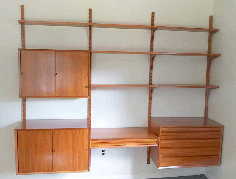 725. Cado Teak Three Bay Wall Unit. | $1,045.50