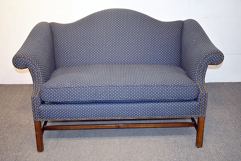 778. Baker Chippendale-style Mahogany Settee.| $430.50