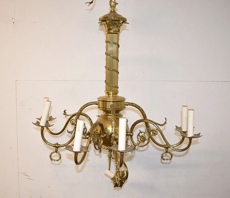 859. Victorian Brass Eight-Arm Chandelier. | $73.80