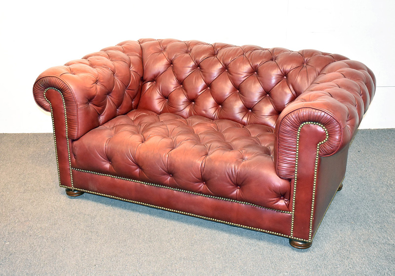 92. Chesterfield Burgundy Tufted Leather Loveseat |  $649