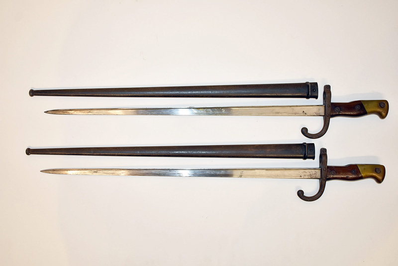 133. Two French Bayonets with Scabbards |  $177
