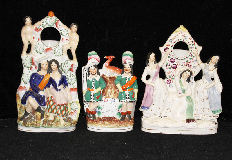 204. Three Staffordshire Figural Watch Holders |  $206.50
