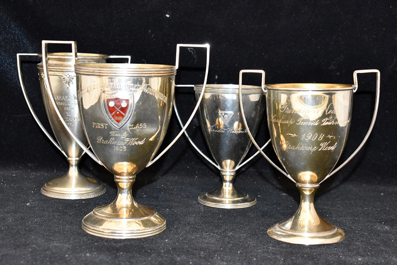 206I. Four Sterling Silver Trophies |  $531