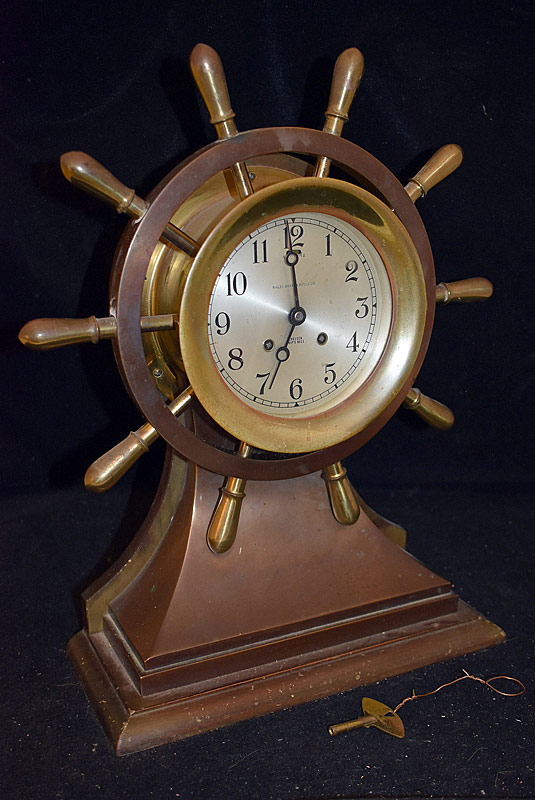 2. Large Chelsea Ship Bell Clock in Ship\\'s Wheel Case |  $1,534