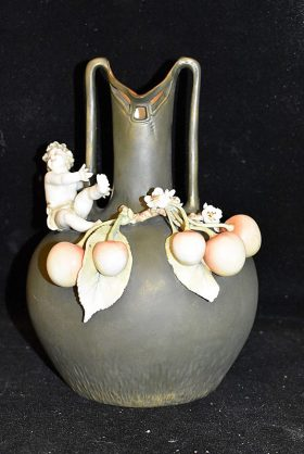 22. Porcelain Vase with Applied Cherub and Cherries |  $70.80