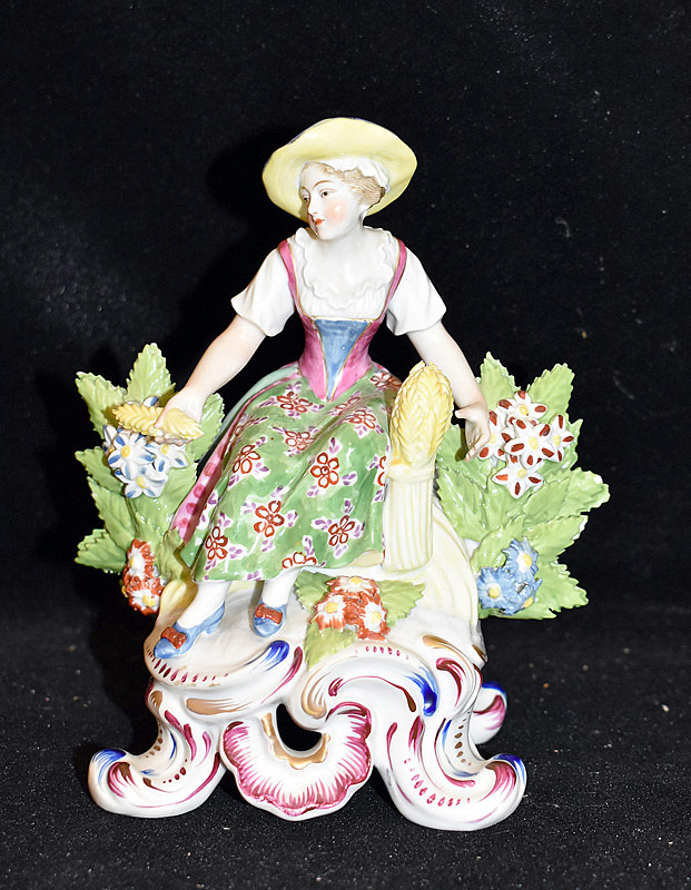23. Chelsea Porcelain Figure of Seated Woman |  $35.40