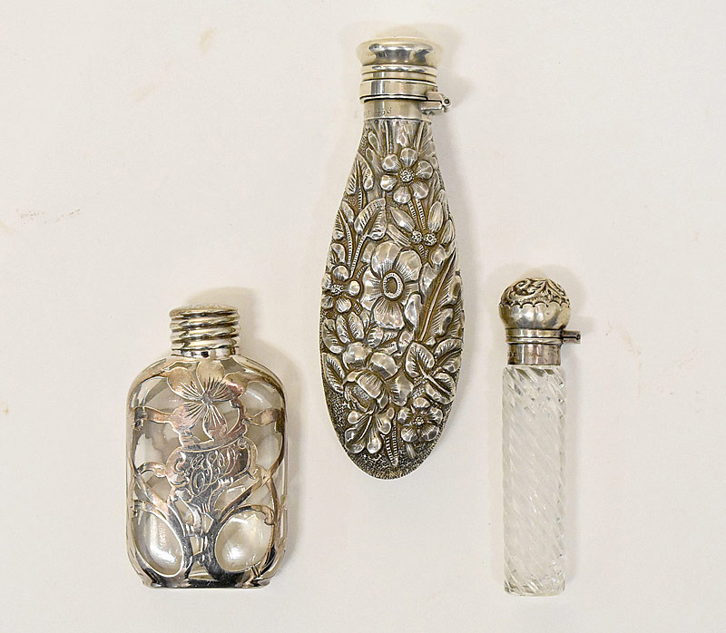 25. Three Sterling & Glass Perfume Bottles |  $153.75