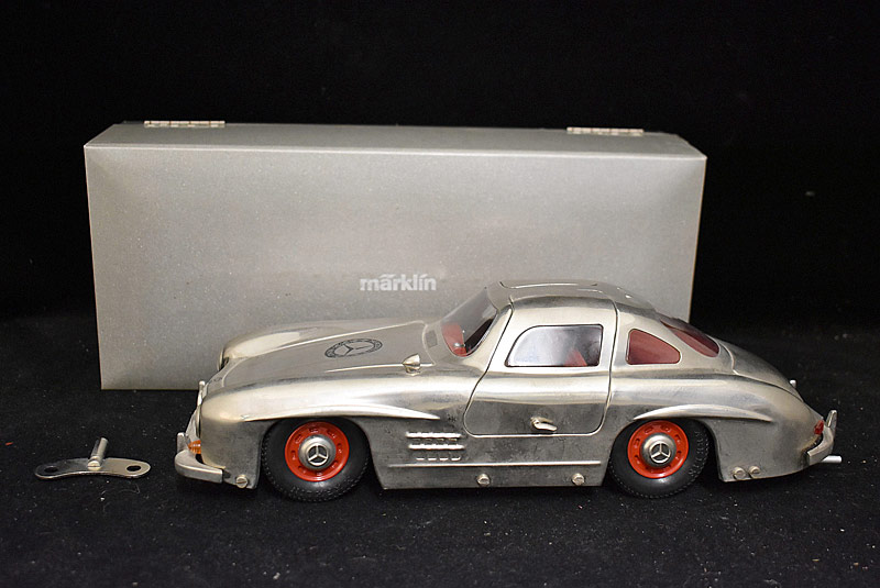 93. Boxed Marklin Tin Wind-up Mercedes 300SL Replica |  $118