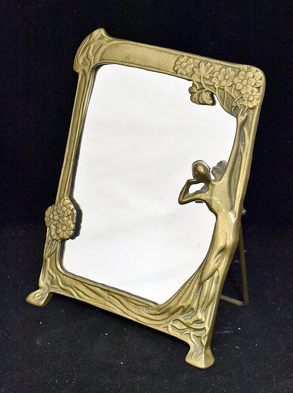 95. Art Nouveau Brass-framed Table Mirror |  $59