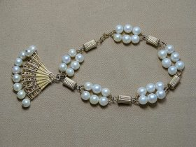 146. 14K Yellow Gold and Pearl Bracelet with Fan Charm |  $295