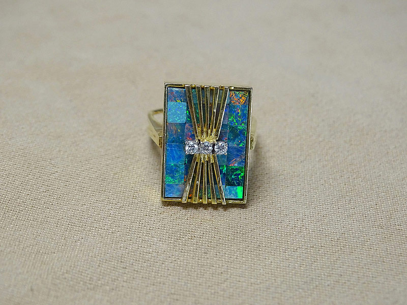 165. Opal and Diamond Ring in 18K Yellow Gold    $399.75