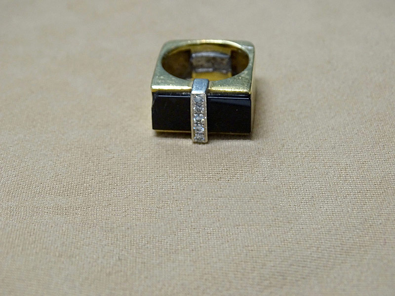 166. Black Onyx and Diamond Ring in 18K Yellow Gold |  $177
