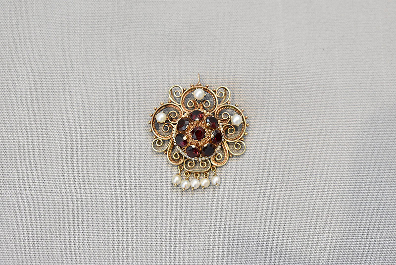 175. Garnet and Pearl Brooch in 14K |  $265.50