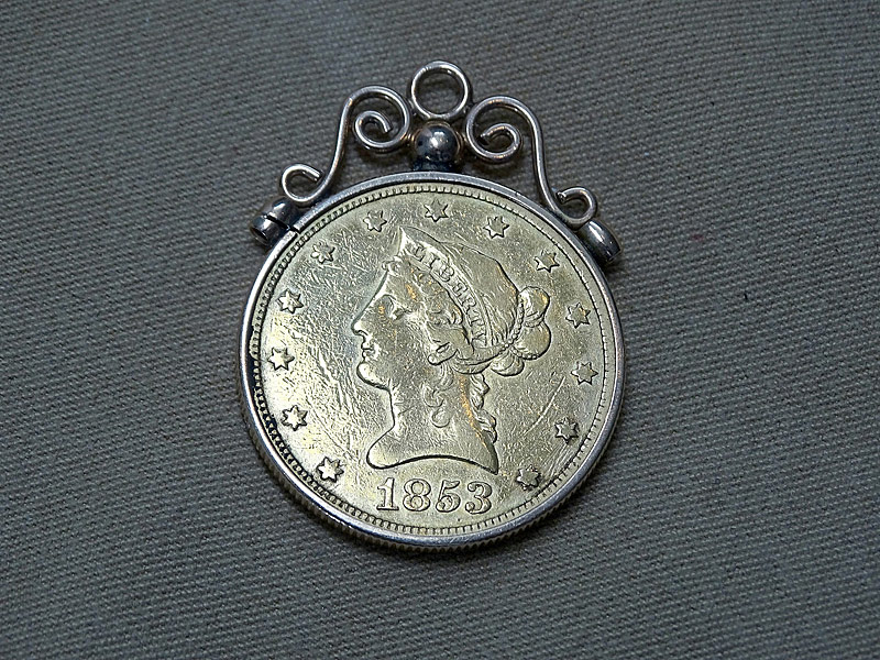 179. 1853 U.S. $10 Gold Coin Pendant in 10K YG |  $649