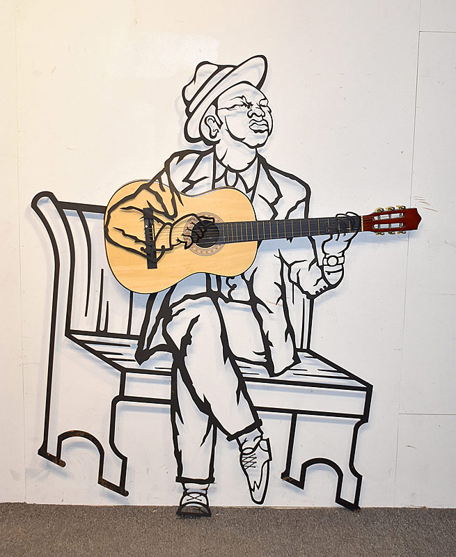 325. Rich Backer. Iron Wall Sculpture, Guitar Player |  $354