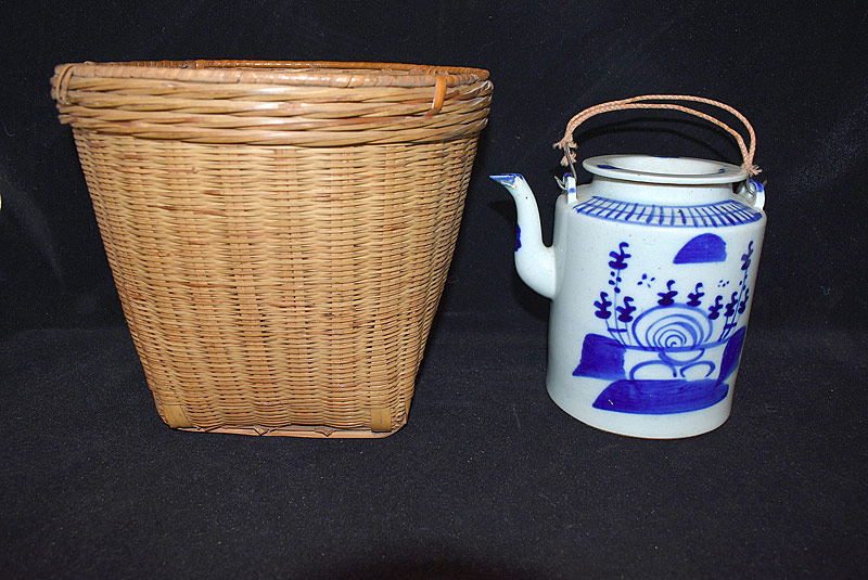 8. Chinese Blue & White Teapot with Basket |  $35.40