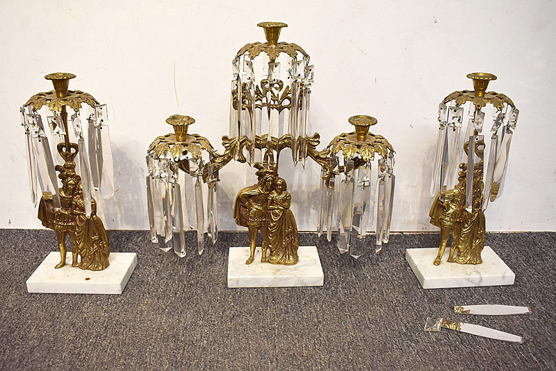 27. Three-piece Figural Brass Girandole Set |  $59