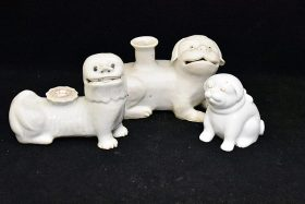 44. Three Chinese Blanc De Chine Porcelain Dogs    $215.25