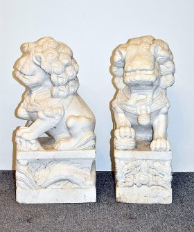 55. Pair of Carved Marble Foo Dogs    $338.25