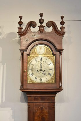 87. Chippendale Carved Walnut Tall Clock    $2,337