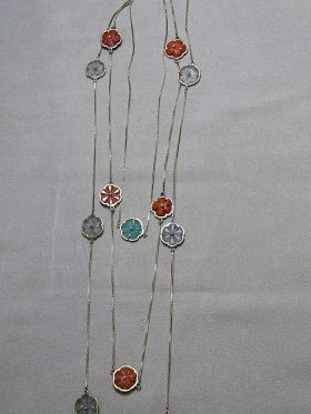 205. Three Gold Floral Necklaces    $492