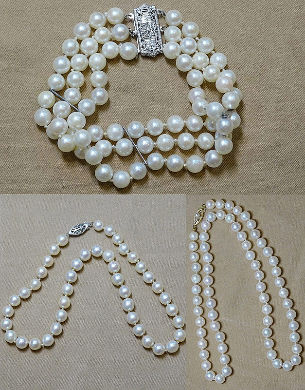 208. Triple Strand Pearl Bracelet & 2 Strands of Pearls |  $246
