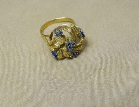 220F. Gold and Sapphire Ring    $206.50